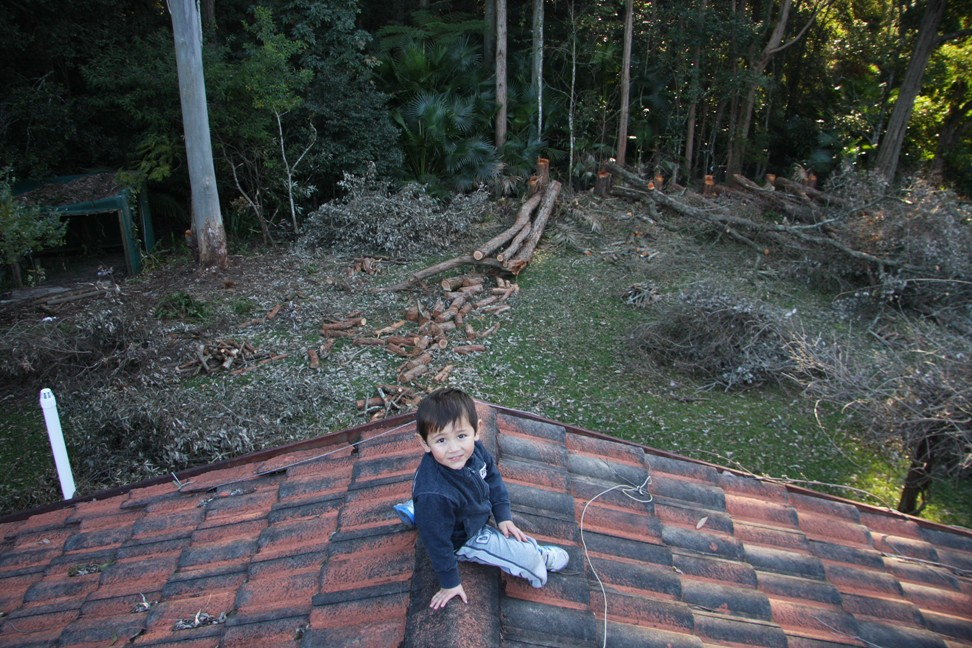 Fidel on roof with Dad checking out progress